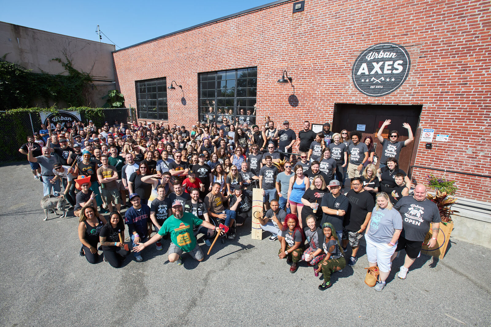 A zoomed out photo of all the participants of the 2019 Urban Open outside of Urban Axes Baltimore